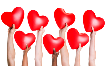 Multi-ethnic group of people's hand holding heart