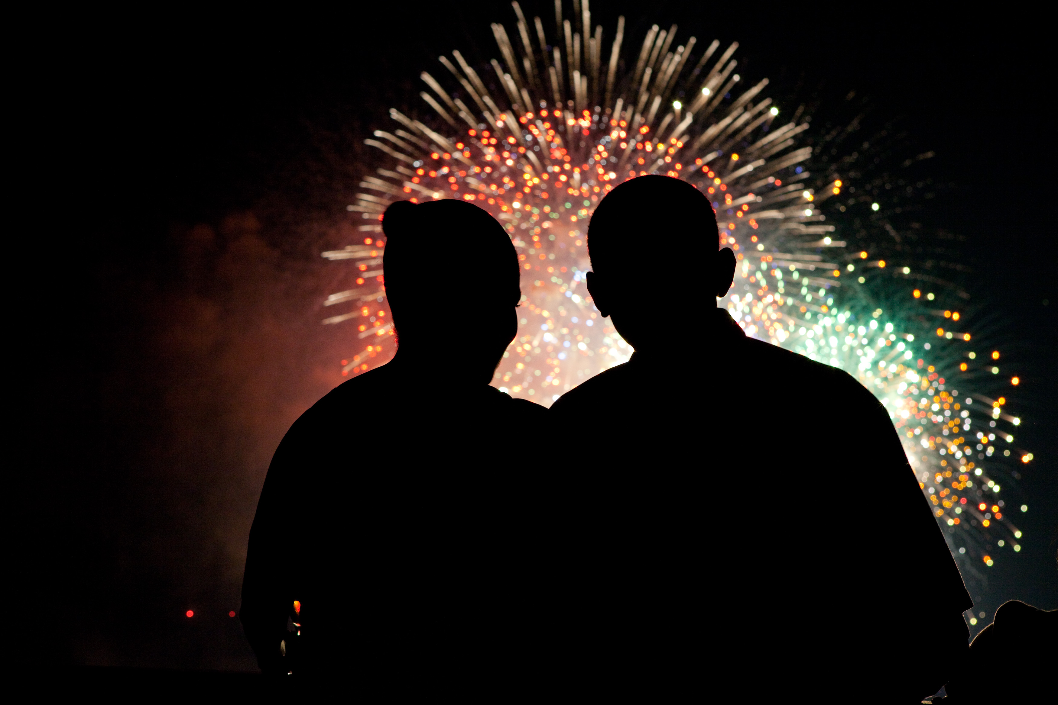 President Barack Obama and First Lady Michelle Obama watch the fireworks over the National Mall from White House on July 4, 2009. (Official White House photo by Pete Souza)  This official White House photograph is being made available for publication by news organizations and/or for personal use printing by the subject(s) of the photograph. The photograph may not be manipulated in any way or used in materials, advertisements, products, or promotions that in any way suggest approval or endorsement of the President, the First Family, or the White House.